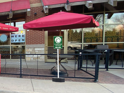 Curbside pickup in front of restaurant rubber base sign stand
